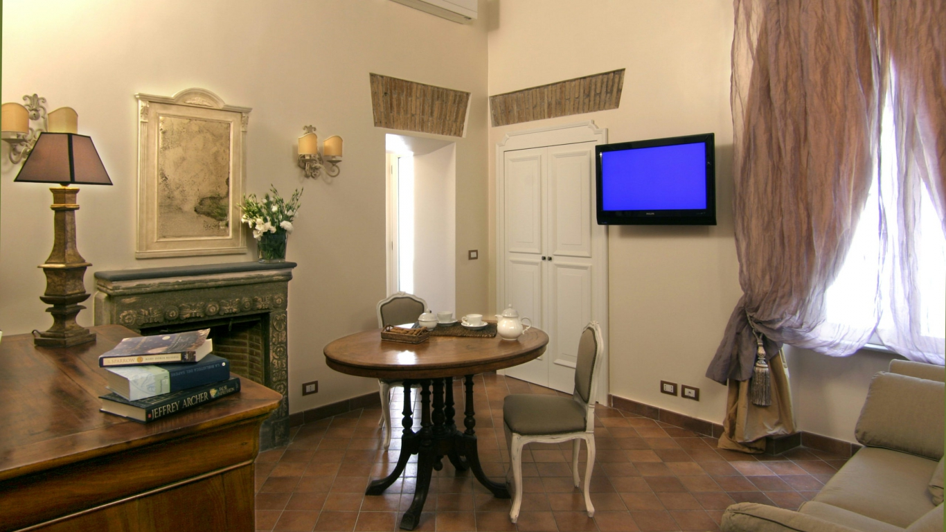 Elite-Apartments-Roma-Ripetta-suite-sala-de-estar